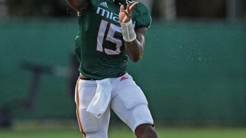 <p>               Miami quarterback Jarren Williams passes during an NCAA college football practice in Coral Gables, Fla., Thursday, Aug. 8, 2019. (David Santiago/Miami Herald via AP)             </p>