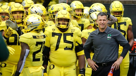 <p>               FILE - In this Nov. 23, 2018, file photo, Oregon coach Mario Cristobal stands with players before the team's NCAA college football game against Oregon State in Corvallis, Ore. The Ducks are the highest-ranked Pac-12 team and the North Division favorite. They go into Saturday night's game against Auburn, the opener of Cristobal's second season, with a three-game winning streak after a 9-4 season. (AP Photo/Timothy J. Gonzalez, File)             </p>