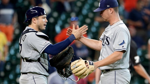 <p>               Tampa Bay Rays catcher Travis d'Arnaud, left, and closing pitcher Emilio Pagan, right, celebrate their win over the Houston Astros at the end of a baseball game Thursday, Aug. 29, 2019, in Houston. (AP Photo/Michael Wyke)             </p>
