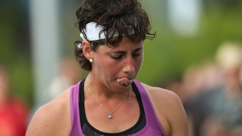 <p>               Carla Suarez Navarro, of Spain, reacts after losing a point to Timea Babos, of Hungary, during the first round of the US Open tennis tournament Tuesday, Aug. 27, 2019, in New York. (AP Photo/Eduardo Munoz Alvarez)             </p>