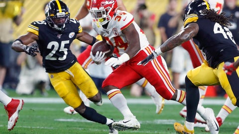 <p>               Kansas City Chiefs running back Carlos Hyde (34) runs between Pittsburgh Steelers outside linebacker Bud Dupree (48) and cornerback Artie Burns (25) in the first half of a preseason NFL football game, Saturday, Aug. 17, 2019, in Pittsburgh. (AP Photo/Don Wright)             </p>