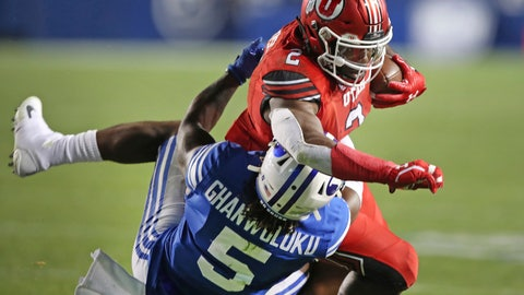 <p>               BYU defensive back Dayan Ghanwoloku (5) takes down Utah running back Zack Moss (2) in the second half during an NCAA college football game, Thursday, Aug. 29, 2019, in Provo, Utah. (AP Photo/George Frey)             </p>