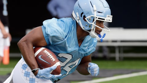 <p>               North Carolina running back Antonio Williams (24) runs the ball during NCAA college football practice Friday, Aug. 2, 2019 in Chapel Hill, N.C. (AP Photo/Gerry Broome)             </p>