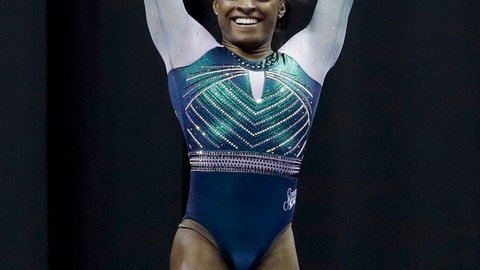 <p>               Simone Biles celebrates after competing on the beam at the U.S. Gymnastics Championships on Friday, Aug. 9, 2019, in Kansas City, Mo. (AP Photo/Charlie Riedel)             </p>