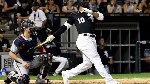 <p>               Chicago White Sox's Yoan Moncada (10) hits a one-run double against the Minnesota Twins during the seventh inning of a baseball game, Saturday, July 27, 2019, in Chicago. (AP Photo/David Banks)             </p>