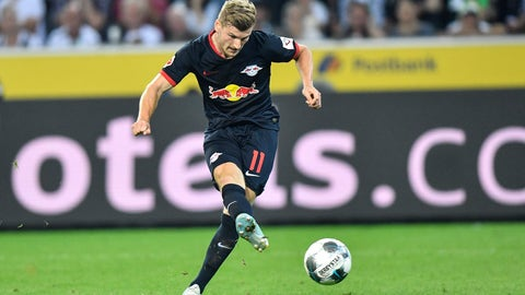 <p>               Leipzig's Timo Werner scores his third goal during the German Bundesliga soccer match between Borussia Moenchengladbach and RB Leipzig in Moenchengladbach, Germany, Friday, Aug. 30, 2019. (AP Photo/Martin Meissner)             </p>