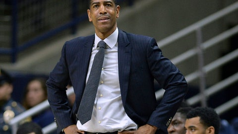 <p>               FILE - In this Feb. 7, 2018, file photo, Connecticut head coach Kevin Ollie watches from the sideline during the first half an NCAA college basketball game in Storrs, Conn. The arbitrator in the dispute between UConn and Kevin Ollie has ruled that the former basketball coach is protected by a union contract when it comes to the standard the school must meet in proving his firing was justified. UConn had argued that Ollie's personal contract superseded the union deal, allowing it to fire him in March, 2018 for a broader range of offenses. (AP Photo/Jessica Hill, File)             </p>