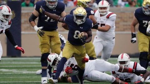 <p>               FILE - In this Sept. 8, 2018, file photo, Notre Dame wide receiver/running back Jafar Armstrong (8) runs with the ball against Ball State during the first half of an NCAA college football game in South Bend, Ind. There is no Dexter Williams in the backfield this season for No. 9 Notre Dame. Instead, the Fighting Irish will look to a stable of running backs to pick up the slack, including Tony Jones and converted wide receiver Jafar Armstrong. (AP Photo/Nam Y. Huh, File)             </p>