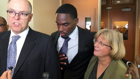 <p>               Quintez Cephus, center, listens as his lawyers, Stephen Meyer, left, and Kathleen Stilling, speak to reporters after Cephus' acquittal on sexual assault charges at the Dane County Courthouse, Friday, Aug. 2, 2019, in Madison, Wis. A jury deliberated for just 30 minutes on Friday before it acquitted the former University of Wisconsin wide receiver Cephus, 21, on charges alleging that he sexually assaulted two female students.  (Ed Treleven/Wisconsin State Journal via AP)             </p>