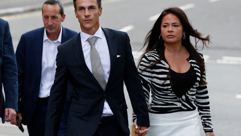 <p>               Danish golfer and Ryder Cup winner Thorbjorn Olesen, left, arrives with an unidentified woman at Uxbridge Magistrates court in London, Wednesday, Aug. 21, 2019, after being charged with sexual assault, being drunk on an aircraft and common assault.  Olesen was arrested on 29 July after returning from the WGC St Jude Invitational on a flight from Nashville to London. Police were waiting for the 29-year-old when the aircraft landed at Heathrow.(AP Photo/Alastair Grant)             </p>