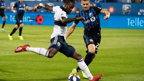 <p>               Vancouver Whitecaps forward Yordi Reyna, left, kicks the ball away from Montreal Impact defender Jukka Raitala during the first half of an MLS soccer match Wednesday, Aug. 28, 2019, in Montreal. (Paul Chiasson/The Canadian Press via AP)             </p>
