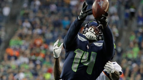 <p>               Seattle Seahawks wide receiver DK Metcalf reaches for an incomplete pass during the first half of the team's NFL football preseason game against the Denver Broncos on Thursday, Aug. 8, 2019, in Seattle. (AP Photo/Elaine Thompson)             </p>