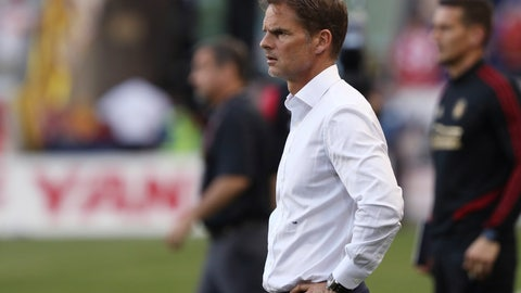 """<p>               FILE - In this May 19, 2019, file photo, Atlanta United coach Frank de Boer watches during the second half of the team's MLS soccer match against the New York Red Bulls in Harrison, N.J. De Boer said he regrets his choice of words in a British newspaper interview about gender equity in soccer and stressed that he's a big supporter of the women's game. De Boer faced backlash before Wednesday's Campeones Cup game for his comments in an article published by The Guardian, in which he said it was """"ridiculous"""" that female players expect to receive the same World Cup pay as the men. (AP Photo/Steve Luciano, File)             </p>"""