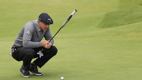 <p>               FILE - In this July 18, 2019, file photo, Bryson DeChambeau, of the United States, looks at his putt on the fourth green during the first round of the British Open Golf Championships at Royal Portrush in Northern Ireland. DeChambeau wasted no time defending himself against accusations of slow play Saturday, Aug. 10, after harsh criticism on social media stemming from a video showing him taking more than two minutes to hit an 8-foot putt at The Northern Trust. (AP Photo/Peter Morrison, File)             </p>