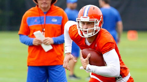 <p>               FILE - In this July 26, 2019, file photo, Florida quarterback Feleipe Franks (13) runs with the ball as head coach Dan Mullen watches during an NCAA college football practice in Gainesville, Fla. (Brad McClenny/The Gainesville Sun via AP, File)             </p>