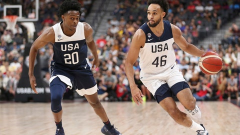 <p>               Team White guard Derrick White (46) dribbles the ball past Team Blue guard De'Aaron Fox (20) during the first half of the U.S. men's basketball team's scrimmage in Las Vegas, Friday, Aug. 9, 2019. (Erik Verduzco/Las Vegas Review-Journal via AP)             </p>