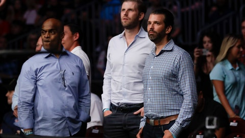 <p>               Donald Trump Jr., right, and Eric Trump, center, watch the post fight ceremony of a lightweight mixed martial arts bout between Jim Miller and Clay Guida at UFC Fight Night Saturday, Aug. 3, 2019, in Newark, N.J. Guida stopped Miller in the first round. (AP Photo/Frank Franklin II)             </p>
