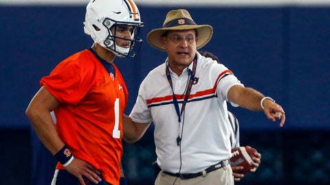 <p>               FILE - In this Aug. 2, 2019, file photo, quarterback Joey Gatewood gets some instruction from coach Gus Malzahn during Auburn NCAA college football practice in Auburn, Ala. Malzahn is banking on his own his play calling abilities and a freshman quarterback to carry the Tigers through a difficult schedule. (AP Photo/Butch Dill, File)             </p>