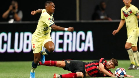 <p>               Atlanta United's Emerson Hyndman has the ball kicked away by Club America midfielder Renato Ibarra, left, during the first half of a Campeones Cup soccer match Wednesday, Aug. 14, 2019, in Atlanta. (AP Photo/John Bazemore)             </p>