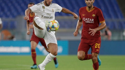 <p>               Real forward Eden Hazard, left, and Roma defender Federico Fazio vie for the ball during a friendly soccer match between Roma and Real Madrid, at the Olympic stadium in Rome, Sunday, Aug. 11, 2019. (AP Photo/Gregorio Borgia)             </p>