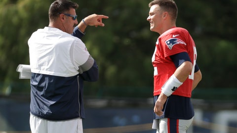<p>               Tennessee Titans head coach Mike Vrabel talks with New England Patriots quarterback Tom Brady during a combined NFL football training camp Wednesday, Aug. 14, 2019, in Nashville, Tenn. Vrabel and Brady were teammates when Vrabel played for the Patriots. (AP Photo/Mark Humphrey)             </p>