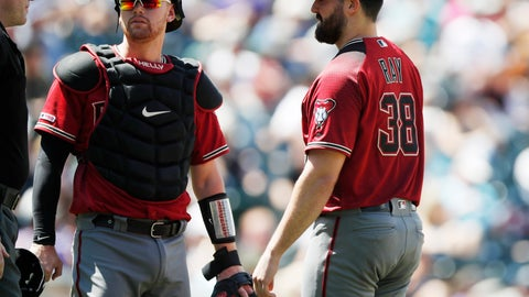 <p>               From left, umpire Chris Conroy confers with Arizona Diamondbacks catcher Carson Kelly and starting pitcher Robbie Ray as he waits to be pulled from the mound before the start of the bottom of the third inning of a baseball game against the Colorado Rockies Wednesday, Aug. 14, 2019, in Denver. Relief pitcher Matt Andriese took over on the mound for Ray. (AP Photo/David Zalubowski)             </p>