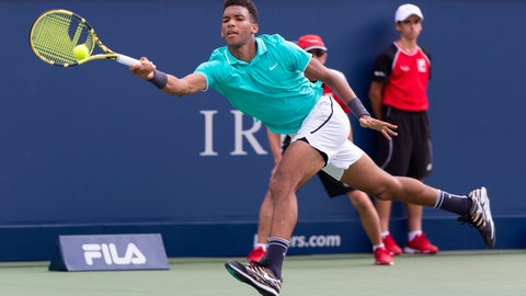 <p>               Felix Auger-Aliassime of Canada lunges to return to compatriot Vasek Pospisil during a first round match at the Rogers Cup tennis tournament in Montreal, Tuesday, Aug. 6, 2019. (Paul Chiasson/The Canadian Press via AP)             </p>