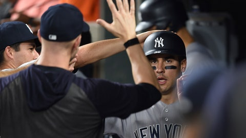 <p>               New York Yankees' Mike Tauchman is congratulated after scoring against the Baltimore Orioles in the fifth inning of a baseball game, Monday, Aug. 5, 2019, in Baltimore. (AP Photo/Gail Burton)             </p>