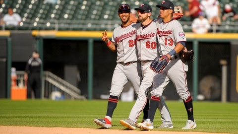 <p>               Minnesota Twins left fielder Eddie Rosario (20), center fielder Jake Cave (60) and right fielder Ehire Adrianza (13) walk in from the outfield after their win over the Chicago White Sox in a baseball game Thursday, Aug. 29, 2019, in Chicago. (AP Photo/Mark Black)             </p>