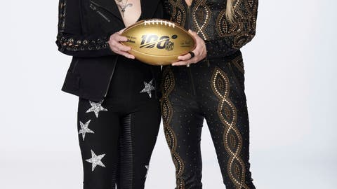 <p>               In this photo provided by NBC Sports, Joan Jett, left, and Carrie Underwood pose with a 100th anniversary NFL football. NBC's Sunday Night Football open will return to the original Waiting All Day for Sunday Night song, but this time Carrie Underwood will be joined by Rock & Roll Hall of Fame inductee Joan Jett. Her band, the Blackhearts, also perform in the open, which features NFL stars. (Virginia Sherwood/NBC Sports via AP)             </p>