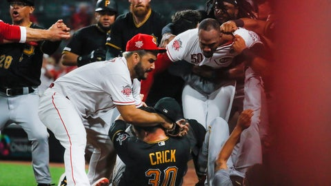 <p>               Pittsburgh Pirates' Kyle Crick (30) falls between Cincinnati Reds' Eugenio Suarez, left, and Amir Garrett (50) during a brawl in the ninth inning of a baseball game Tuesday, July 30, 2019, in Cincinnati. (AP Photo/John Minchillo)             </p>