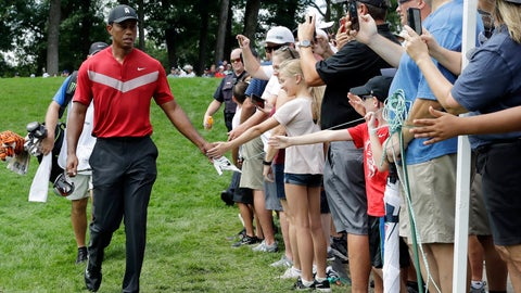 <p>               Tiger Woods, left, greets fans as he walks to the 14th fairway after hitting his tee shot during the final round of the BMW Championship golf tournament at Medinah Country Club, Sunday, Aug. 18, 2019, in Medinah, Ill. (AP Photo/Nam Y. Huh)             </p>