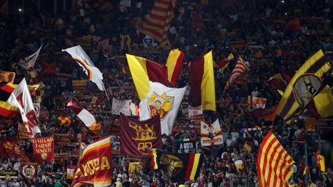 <p>               Roma's supporters wave flags during the Serie A soccer match between Roma and Genoa at the Rome Olympic stadium, Sunday, Aug. 25, 2019. (AP Photo/Alessandra Tarantino)             </p>