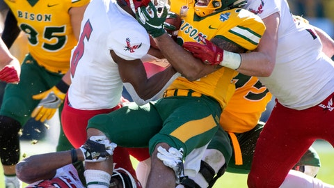 <p>               CORRECTS TO UPDATE WILSON IS LOST FOR THE SEASON - FILE - In this Jan. 5, 2019, file photo, North Dakota State running back Seth Wilson is wrapped up by Eastern Washington defensive back Nzuzi Webster (6), defensive back Anfernee Gurley, right, and linebacker Chris Ojoh (58) during the first half of the FCS championship NCAA college football game in Frisco, Texas. Wilson averaged more yards per carry last year than any other regular back and was expected to play a key role until he was lost for the season to knee injury for a team that is already replacing eight players on offense and seven on defenses. Despite all the holes to fill, the defending FCS champs are is ranked No. 1 in a preseason poll of FCS coaches. (AP Photo/Jeffrey McWhorter, File)             </p>