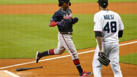 <p>               Atlanta Braves' Ronald Acuna Jr., left, crosses home plate to score as Miami Marlins starting pitcher Hector Noesi (48) backs up home plate during the first inning of a baseball game, Sunday, Aug. 11, 2019, in Miami. (AP Photo/Wilfredo Lee)             </p>