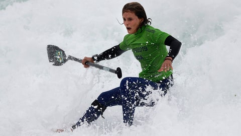 <p>               Brazil's Lena Guimaraes rides the surf to win the gold medal in the women's SUP race final during the Pan American Games on Punta Rocas beach in Lima Peru, Friday, Aug.2, 2019. (AP Photo/Silvia Izquierdo)             </p>