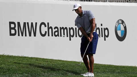 <p>               Tiger Woods chips an approach shot on the 12th hole during the pro-am round of the BMW Championship golf tournament at Medinah Country Club, Wednesday, Aug. 14, 2019, in Medinah, Ill. (AP Photo/Nam Y. Huh)             </p>