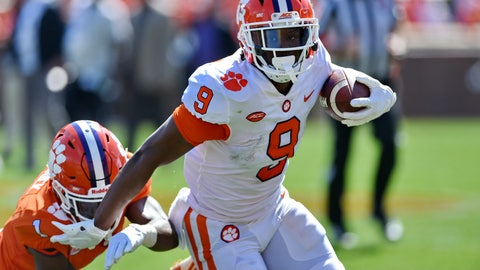 <p>               FILE - In this April 6, 2019, file photo, Clemson's Travis Etienne (9) rushes out of the tackle attempt by Derion Kendrick during Clemson's annual Orange and White NCAA college football spring scrimmage in Clemson, S.C. Etienne is one of three Clemson Tigers selected an AP preseason All-American along with quarterback Trevor Lawrence and linebacker Isaiah Simmons. (AP Photo/Richard Shiro, File)             </p>