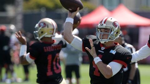 <p>               San Francisco 49ers quarterback Nick Mullens, right, throws a pass at the team's NFL football training camp in Santa Clara, Calif., Monday, July 29, 2019. (AP Photo/Jeff Chiu)             </p>