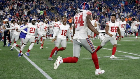 <p>               Teammates rush to congratulate New York Giants wide receiver Alonzo Russell (84) after he caught a touchdown pass to win an NFL preseason football game against the New England Patriots, Thursday, Aug. 29, 2019, in Foxborough, Mass. (AP Photo/Elise Amendola)             </p>