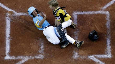 <p>               Wailuku, Hawaii's Nakea Kahalehau, left, scores under the tag by South Riding, Va.'s Noah Culpepper during the first inning of a baseball game at the Little League World Series in South Williamsport, Pa., Wednesday, Aug. 21, 2019. Hawaii won 12-9. (AP Photo/Gene J. Puskar)             </p>