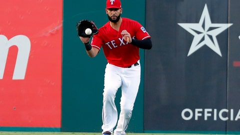 <p>               Texas Rangers' Nomar Mazara fields a run-scoring single by Los Angeles Angels' Kole Calhoun in the first inning of baseball game in Arlington, Texas, Monday, Aug. 19, 2019. Shohei Ohtani scored on the hit. (AP Photo/Tony Gutierrez)             </p>