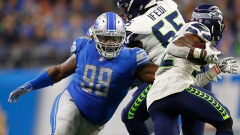 """<p>               FILE - In this Oct. 28, 2018, file photo, Detroit Lions defensive tackle Damon Harrison (98) tackles Seattle Seahawks running back Chris Carson (32) during an NFL football game in Detroit. The Detroit Lions have signed defensive tackle Damon """"Snacks"""" Harrison to an $11 million, one-year extension. The team announced the signing Thursday, Aug. 22, 2019. (AP Photo/Paul Sancya, File)             </p>"""