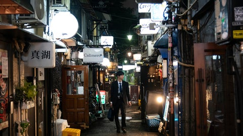<p>               A man strolls through a narrow alleyway clustered with tiny bars and restaurants at the Golden Gai in the Shinjuku district of Tokyo, July 17, 2019. (AP Photo/Jae C. Hong)             </p>