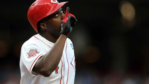 <p>               Cincinnati Reds' Aristides Aquino celebrates after hitting a solo home run, his second home run of the game, in the third inning of a baseball game against the Chicago Cubs, Saturday, Aug. 10, 2019, in Cincinnati. (AP Photo/Aaron Doster)             </p>