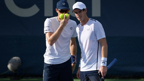 <p>               Andy Murray, right, talks with Jamie Murray, left, both of Britain, as they played a doubles match against Raven Klaasen, of South Africa, and Michael Venus, of New Zealand, in the Citi Open tennis tournament, Friday, Aug. 2, 2019, in Washington. (AP Photo/Nick Wass)             </p>