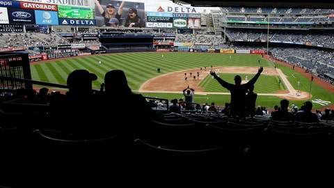 <p>               FILE - In this May 15, 2019, file photo, fans cheer during the seventh inning stretch during in the first baseball game of a doubleheader between the New York Yankees and the Baltimore Orioles at Yankee Stadium in New York. The Yankees have reacquired the YES Network, partnering with Amazon.com and the Sinclair Broadcast Group to purchase 80 percent of the station from The Walt Disney Co. Thursday, Aug. 29, 2019, in a deal that values it at $3.47 billion.   (AP Photo/Frank Franklin II)             </p>
