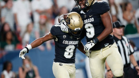 <p>               Colorado tight end Jalen Harris, right, celebrates with running back Alex Fontenot, who scored a touchdown against Colorado State in the third quarter of an NCAA college football game Friday, Aug. 30, 2019, in Denver. (AP Photo/David Zalubowski)             </p>