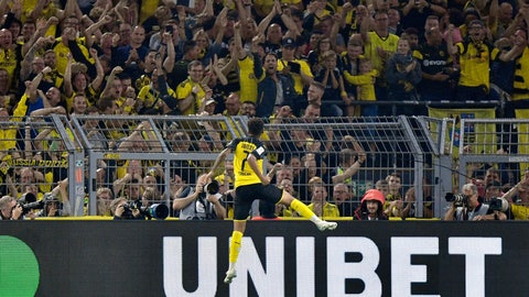 <p>               Dortmund's Jadon Sancho celebrates after scoring his side's second goal during the German Supercup final soccer match between Borussia Dortmund and Bayern Munich in Dortmund, Germany, Saturday, Aug. 3, 2019. (AP Photo/Martin Meissner)             </p>