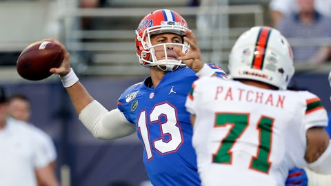 <p>               Florida quarterback Feleipe Franks (13) throws a pass as he is pressured by Miami defensive lineman Scott Patchan (71) during the first half of an NCAA college football game Saturday, Aug. 24, 2019, in Orlando, Fla. (AP Photo/John Raoux)             </p>